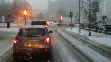 Cars took it easy on the roads as the snow began to lie on Monday morning.