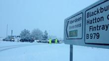 Police directing traffic at Clinterty roundabout at Blackburn.