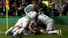 The Celtic team bury midfielder Victor Wanyama after his goal in the second leg against Helsingborgs IF. Celtic progressed to the group stages.