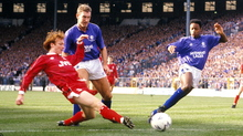Terry Butcher and Mark Walters look on as future manager Alex McLeish slides in for Aberdeen