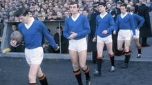 A young John Greig leads Rangers out