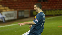 Jamie Murphy opened the scoring for Motherwell at Pittodrie.