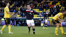 Steven Milne got Dundee off to the perfect start at Livingston.