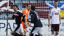 Dundee broke their Dens Park duck thanks to a Matt Lockwood free kick against Hearts.