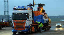 Helicopter loaded onto lorry.