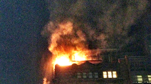 Flames: The fire sent smoke billowing into the night sky.