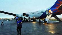 Glasgow Airport: Passengers escaping down emergency chutes