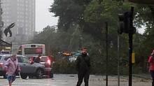 Aberdeen's Union Terrace was shut after a tree fell on a bus.