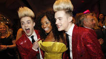 John and Edward poses with Norway's Stella Mvangi