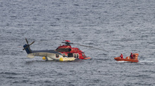 Lifeboats checking the helicopter for missing people
