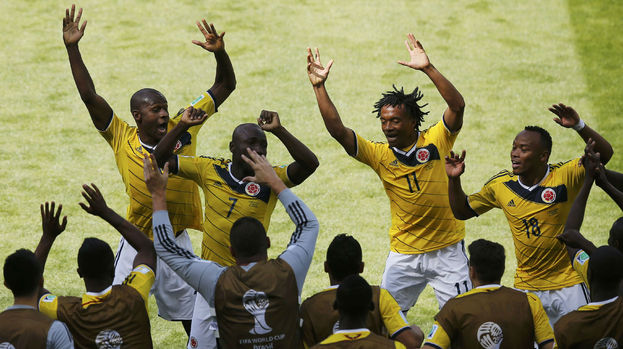 Colombia celebrate against Greece.
