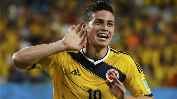James Rodriguez scores for Colombia against Japan at the World Cup.