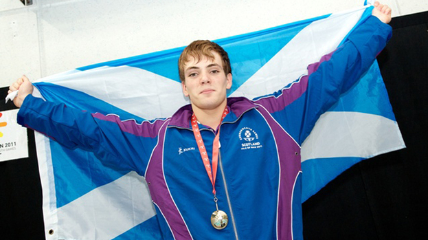 Craig Benson with one of his Youth Commonwealth Games gold medals.