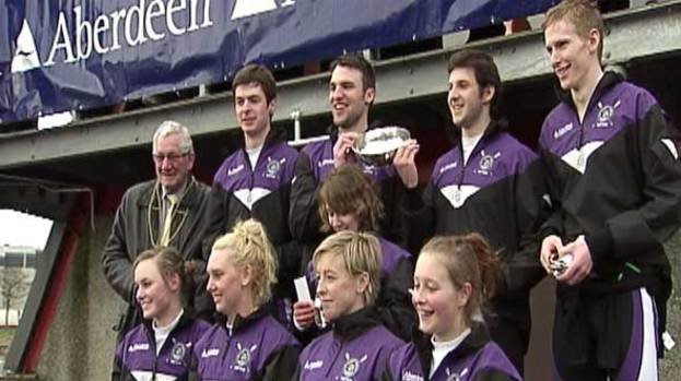 Winners: Robert Gordon University celebrate their boat race victory.