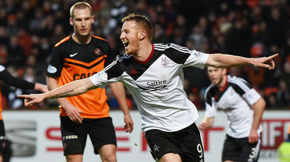 See Adam Rooney score twice for Aberdeen in a 2-0 win over Dundee United
