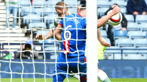 Inverness CT's Josh Meekings (6) appears to handle a header from Leigh Griffiths.