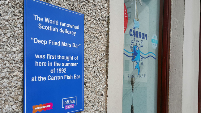 Carron Bar has lost its banner but gained a deep fried Mars bar plaque