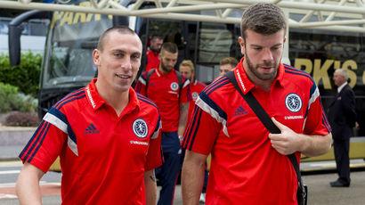 Scotland's Scott Brown (left) and Grant Hanley depart for Georgia