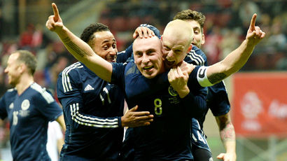 Scotland ace Scott Brown (centre) is mobbed after opening the score