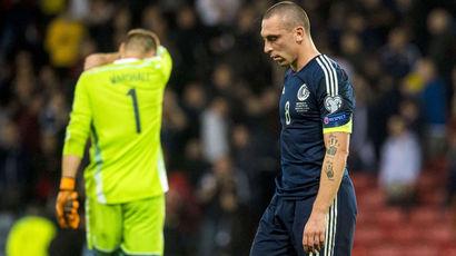 Dejection for Scotland captain Scott Brown