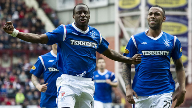 Rangers forward Sone Aluko (left) celebrates alongside team-mate Kyle Bartley after scoring from a free kick.
