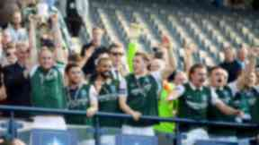 Hibernian captain David Gray joins his team-mates as they celebrate after winning the William Hill Scottish Cup.