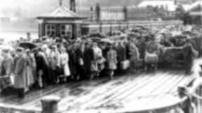 Wemyss Bay: Families gather on the pier in the 1960s awaiting the ferry.