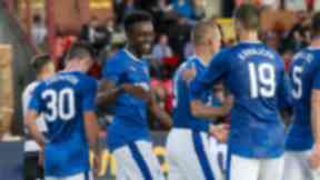 Rangers' Joe Dodoo (left) celebrates with Lee Wallace as he scores his side's third on his debut.