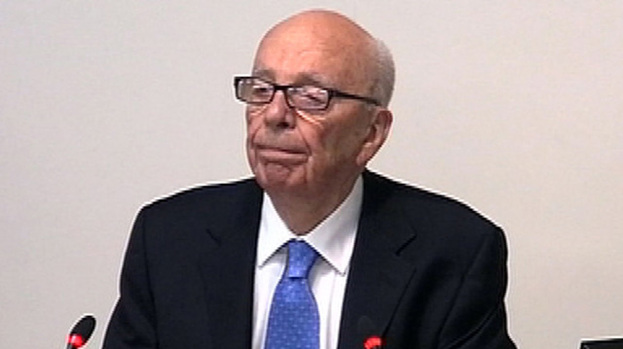 Lips firmly sealed: Rupert Murdoch had plenty to talk about at inquiry this week