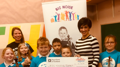 Picture shows: (L-R): Big Noise Torry team leader Laura Horn and STV's Andrea Brymer with children Lauren, Rubi, Krystian, Keith, Krists and Vasilisa.