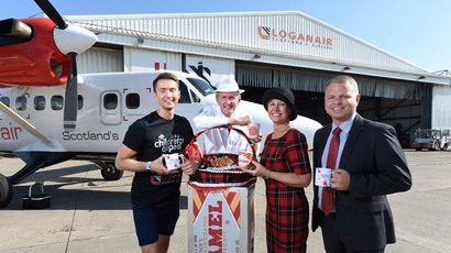 Picture shows (L-R): Sean Batty with Fergus Loudon, operations director at Tunnock's, Tricia Thistle, lead instructor in cabin safety at Loganair and Jonathan Hinkles, managing director at Loganair.