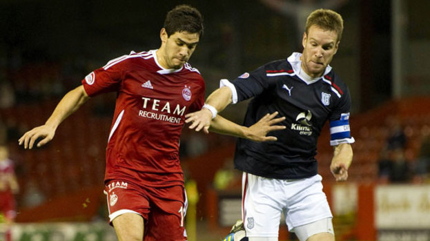 Mohamed Chalali (left) made his competitive debut for Aberdeen in their League Cup win over Dundee.